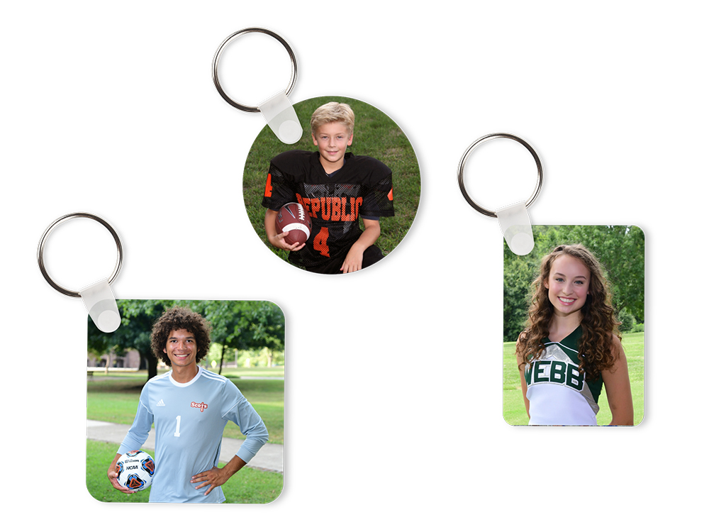 3 metal key chains of different shapes featuring photos of youth sports and events subjects.