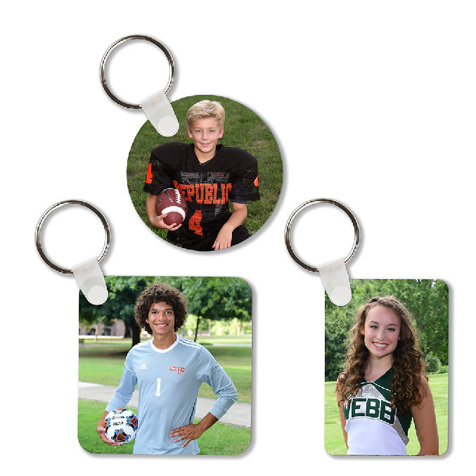 Female cheerleader, male soccer player and male football player on metal key chains.