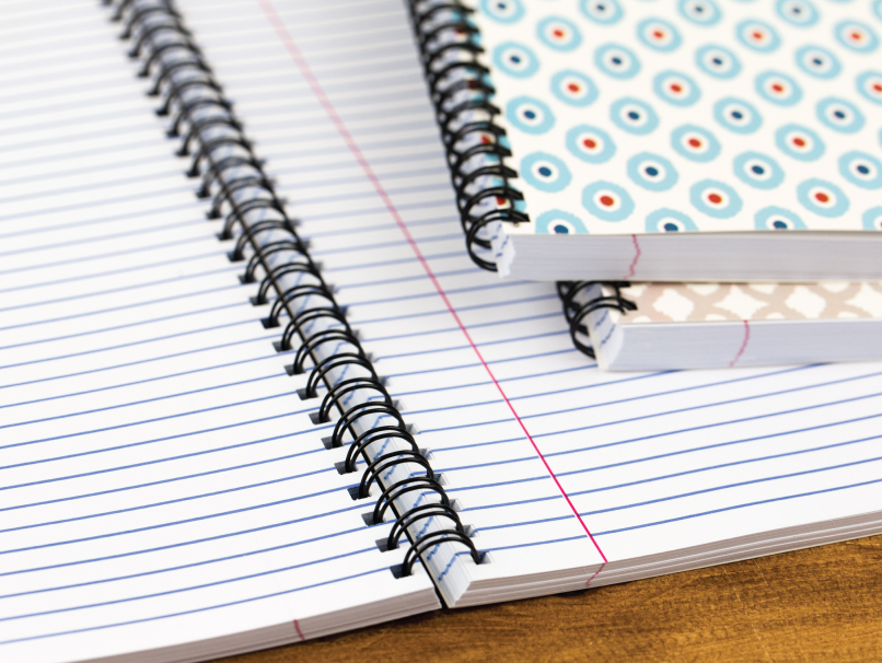 Open Notebook with College-Ruled Paper and Black Spiral Binding