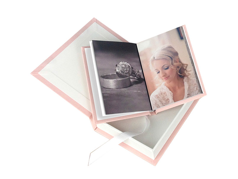 Pink fabric wedding photo open & laying on a matching pink fabric book box
