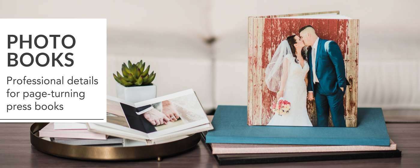 Photo Books Sitting on Coffee Table With Tea Pot