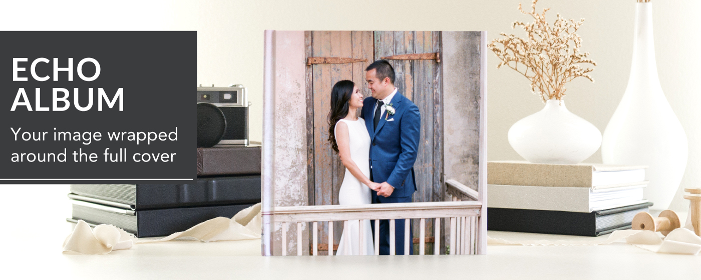 Echo Album on Table with Bride & Groom in Front of a Rustic Door on Photo Cover