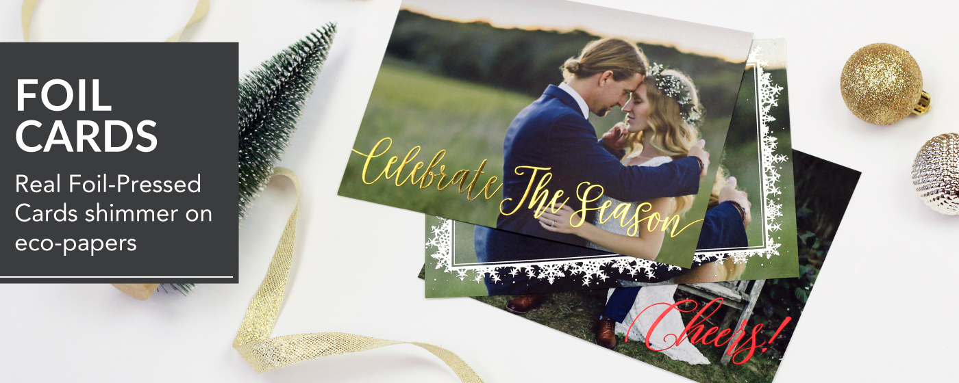 Bride & Groom in loving embrace in a field printed on a flat holiday foil card