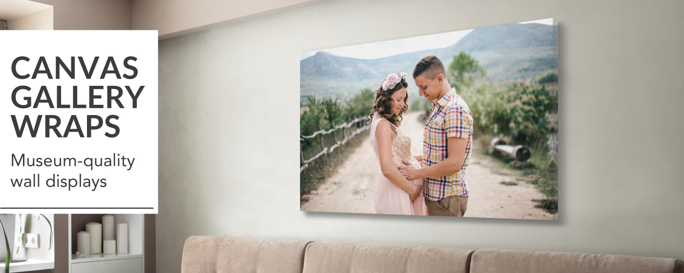 Portrait of Pregnancy Couple printed on Canvas Gallery Wraps displayed over living room sofa
