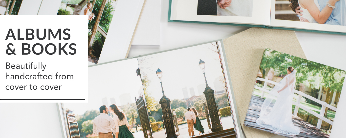 Wedding and Engagement Albums Open on Table