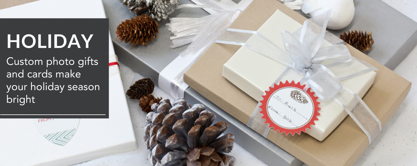 Gifts with Silver Ribbon on Table with Pinecones