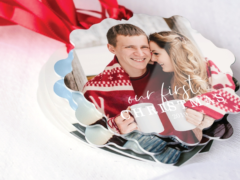 Engagement photo of a man & woman wrapped in a winter blanket holding coffee mugs on a holiday Metal Ornament in one of 13 Shapes