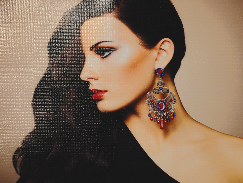 Woman with Ornate Earring Printed with Canvas Texture