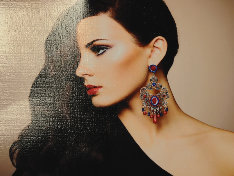 Woman with Ornate Earring Printed with Linen Texture