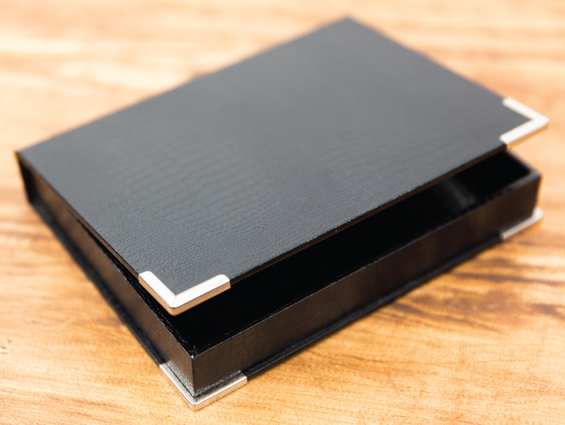 Black Presentation Box for Photo Book on Wooden Table