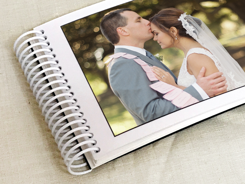 Groom kissing Bride on forehead printed on spiral bound preview print
