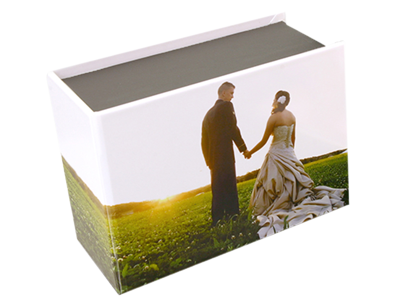 Bride & Groom in a field on the custom photo cover of a print box