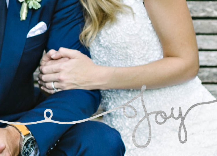 Bride clutching Groom's arm printed on a foil stamped holiday card