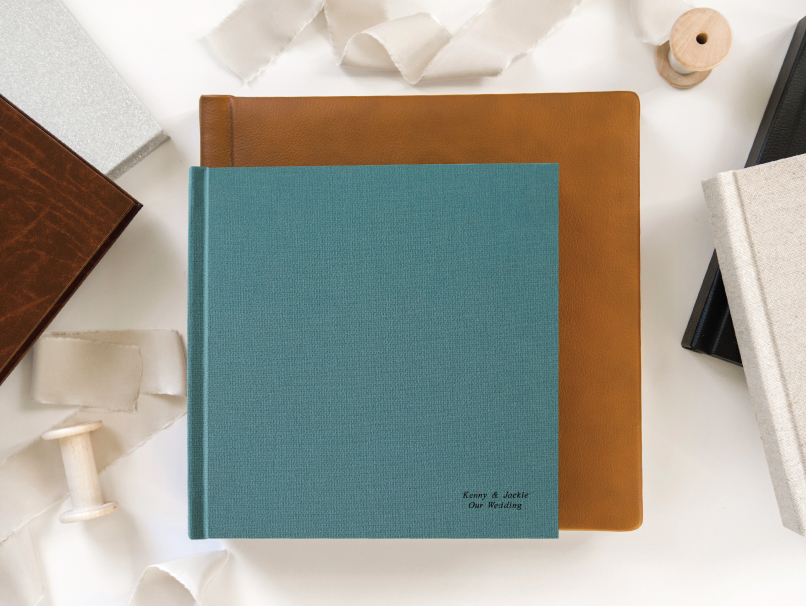 Brown Leather Tuscany Classic and Teal Fabric Tuscany Contemporary with Black Embossing on Cover