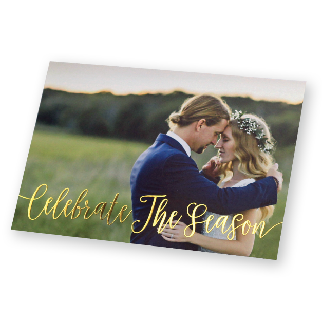 Bride & Groom in loving embrace in a field printed on a folded holiday foil card