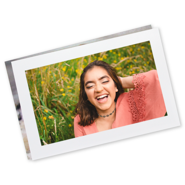 Senior Girl in Pink Shirt in a Field with a Border Printed on a Preview Print
